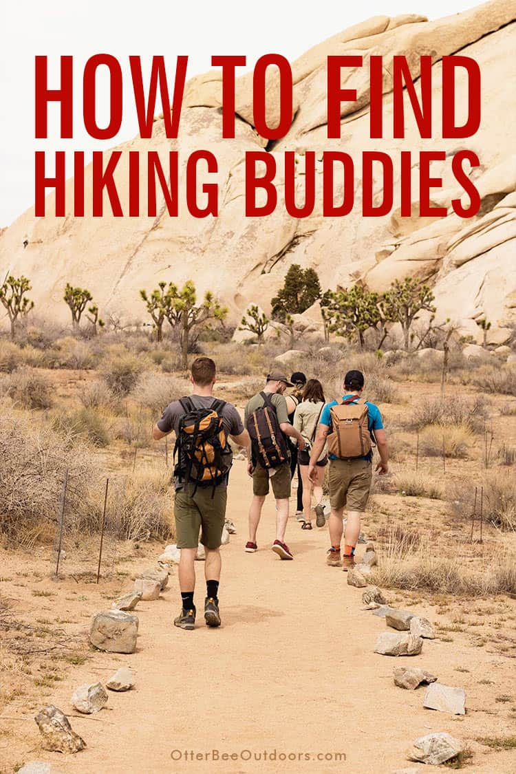 A group of hiking buddies walking along a dusty hiking trail in the desert.