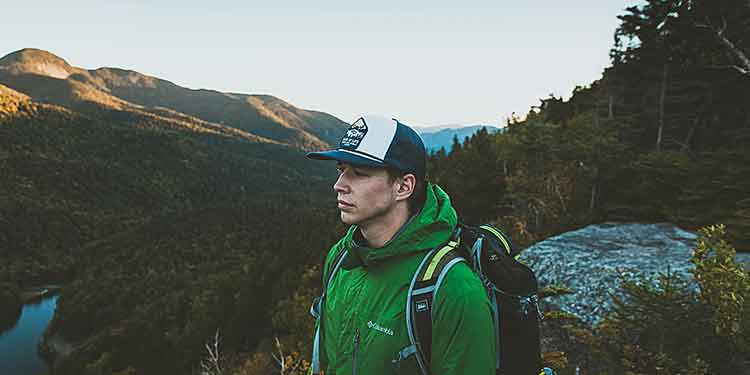 A male hiker on a solo hike in the mountains.