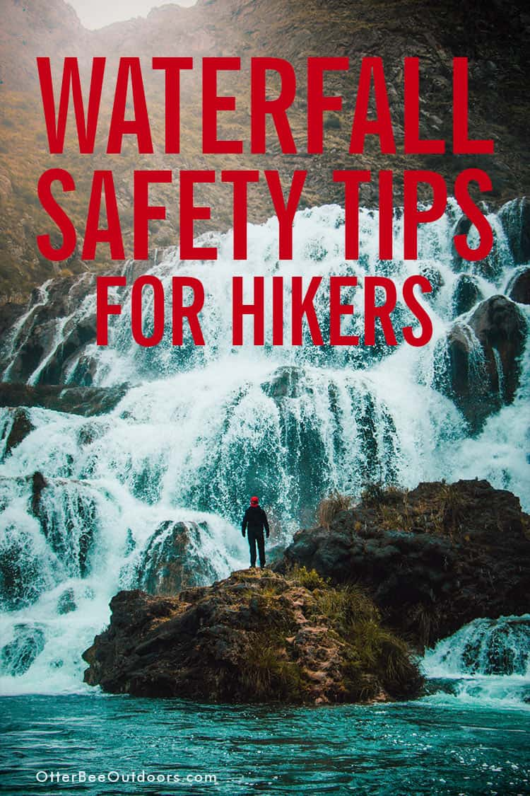A male hiker standing on the rocks at the base of a large waterfall. The text says... Waterfall Safety Tips for Hikers.