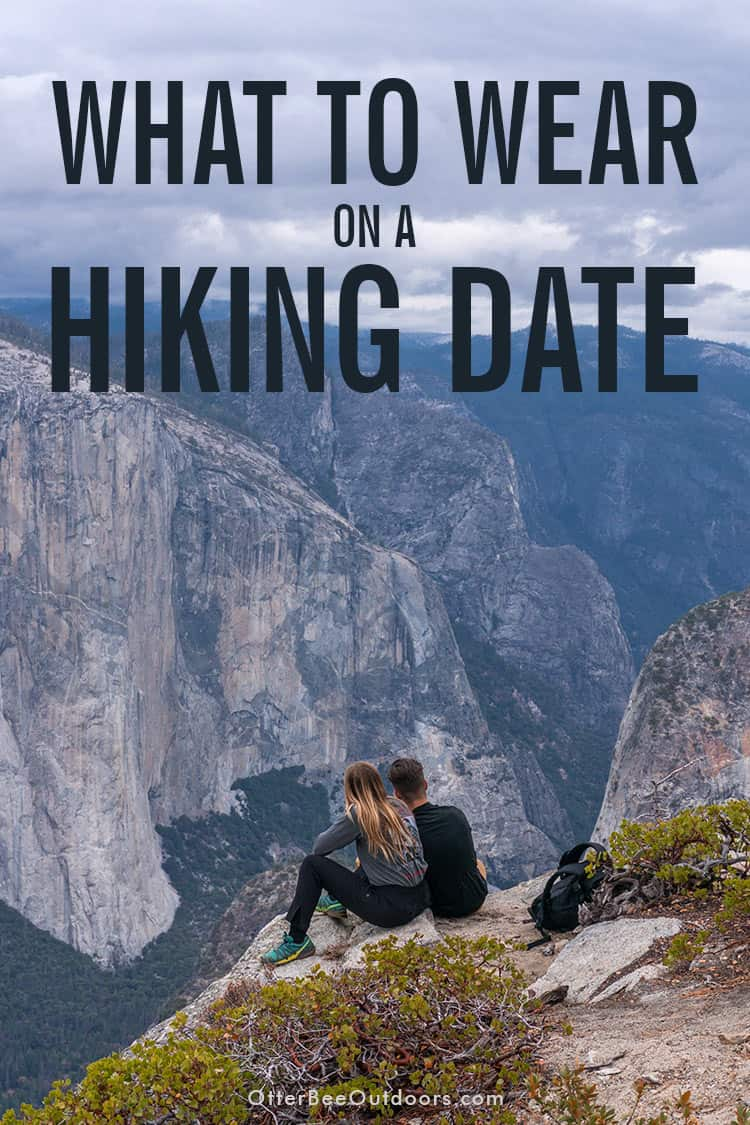 A couple on a hiking date enjoying an impressive view at the edge of a canyon. Text says... What to Wear on a Hiking Date.