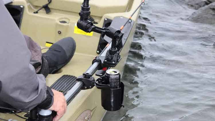 The best canoe and kayak cup holder is self-leveling. Here's the 16oz RAM Level Cup from RAM Mounts secured to a fishing kayak with a clamp base.