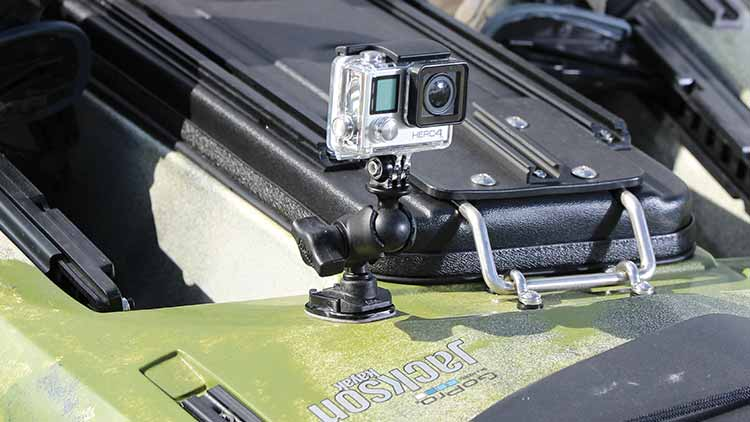 A GoPro on a RAM mount attached to a GoPro adhesive mount on a Jackson Kayak.