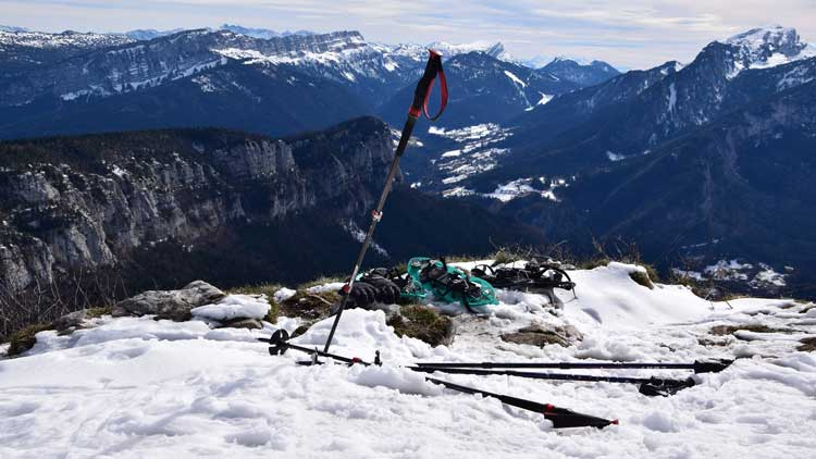 Snowshoeing gear on a mountain trail.