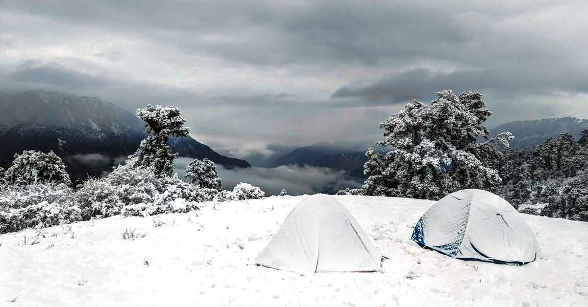 Two winter tents set up in the snow.