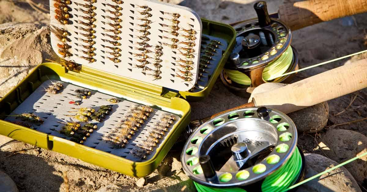 Fly fishing gear: flies, fly box, fly rods and reels.