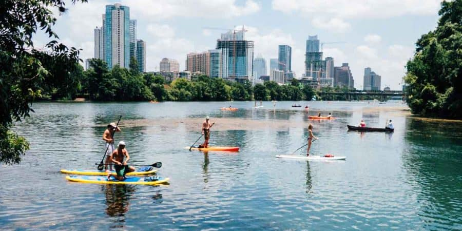 Paddle boarders on the water at Lou Neff Point, Austin, TX.