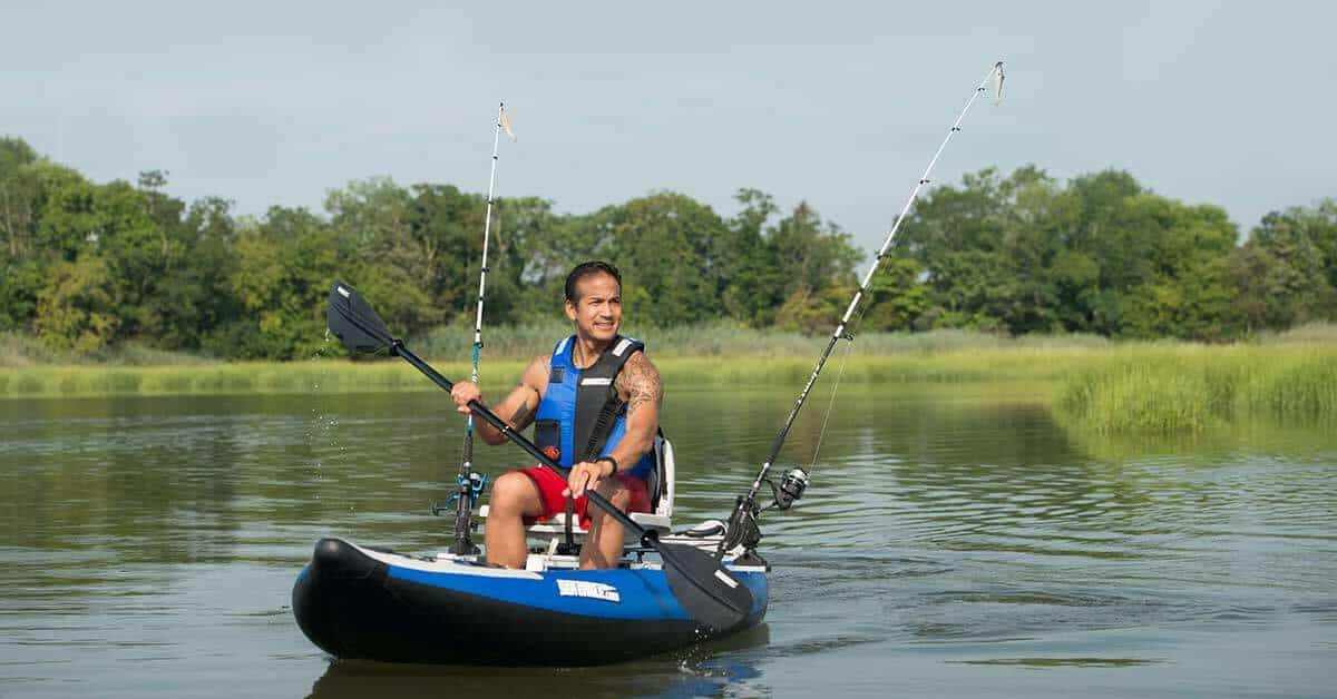 Paddling a Sea Eagle 300x Explorer inflatable kayak outfitted with the Swivel Seat Fishing Rig with Scotty Rod Holders.