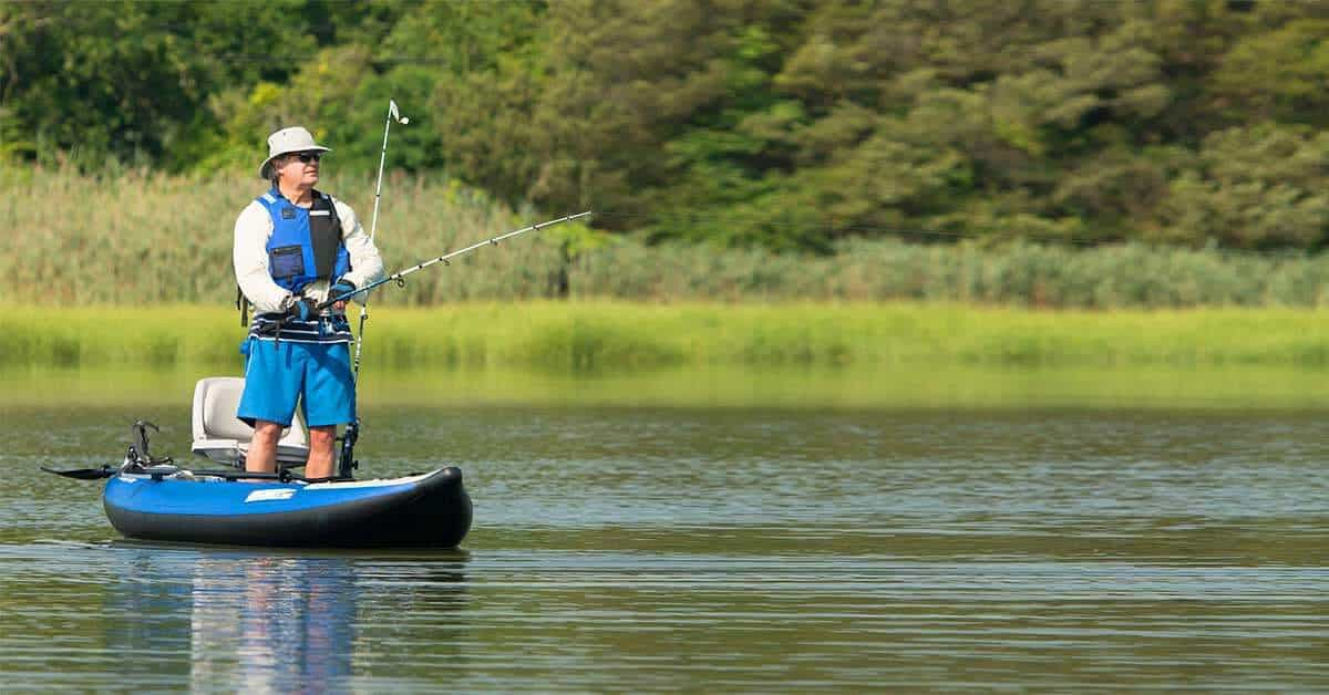Fishing while standing in a Sea Eagle 300x Explorer inflatable kayak outfitted with the Swivel Seat Fishing Rig with Scotty Rod Holders.