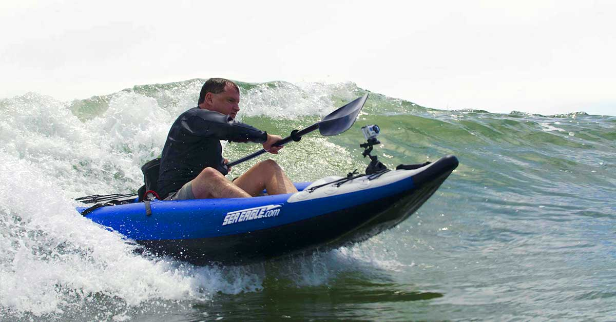Surfing waves in the ocean in a Sea Eagle 300x Explorer inflatable kayak.