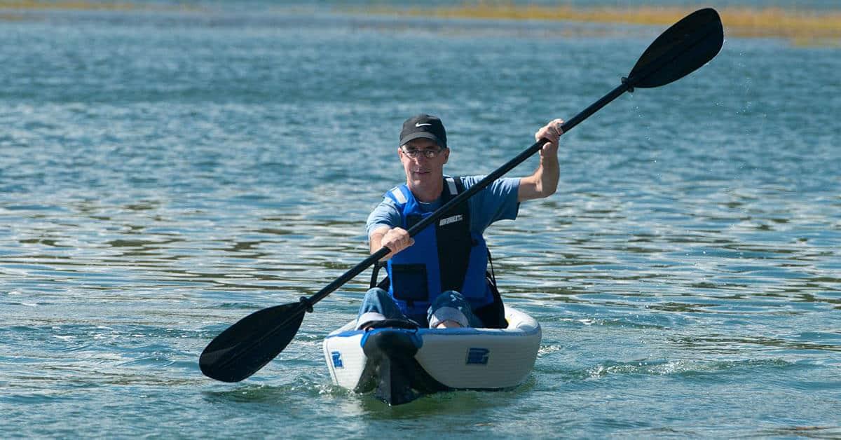 Sea Eagle 393rl RazorLite inflatable kayak being paddled on a flatwater lake.