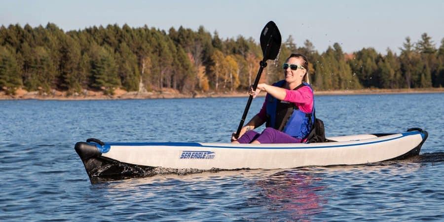 Female kayaker paddling a Sea Eagle 393rl RazorLite inflatable kayak.