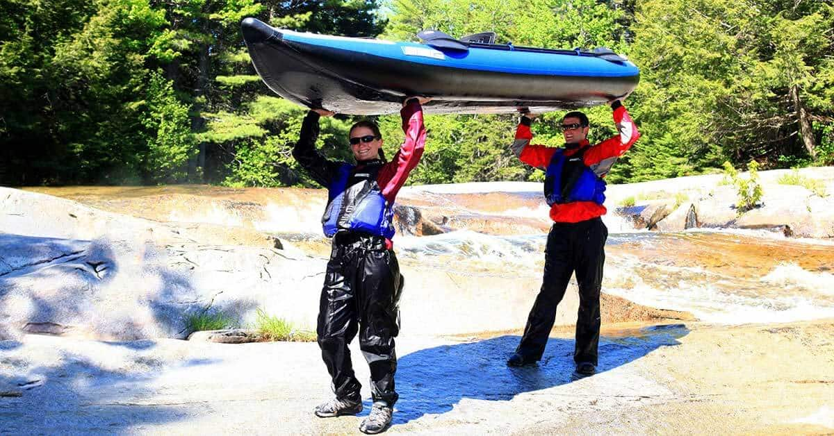 Portaging a Sea Eagle 420x Explorer 2-person inflatable kayak.