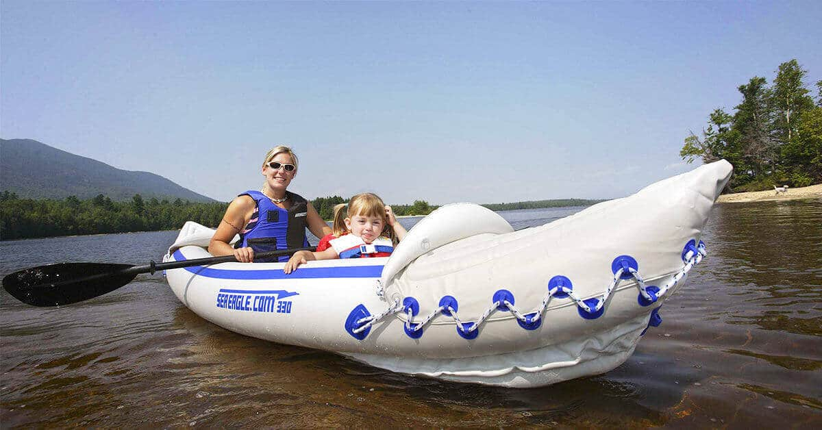 Parent and child kayaking safely in a Sea Eagle 330 Sport Inflatable Kayak.