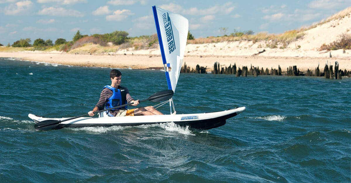 A Sea Eagle 385ft FastTrack inflatable kayak with a QuikSail, universal kayak sail kit.