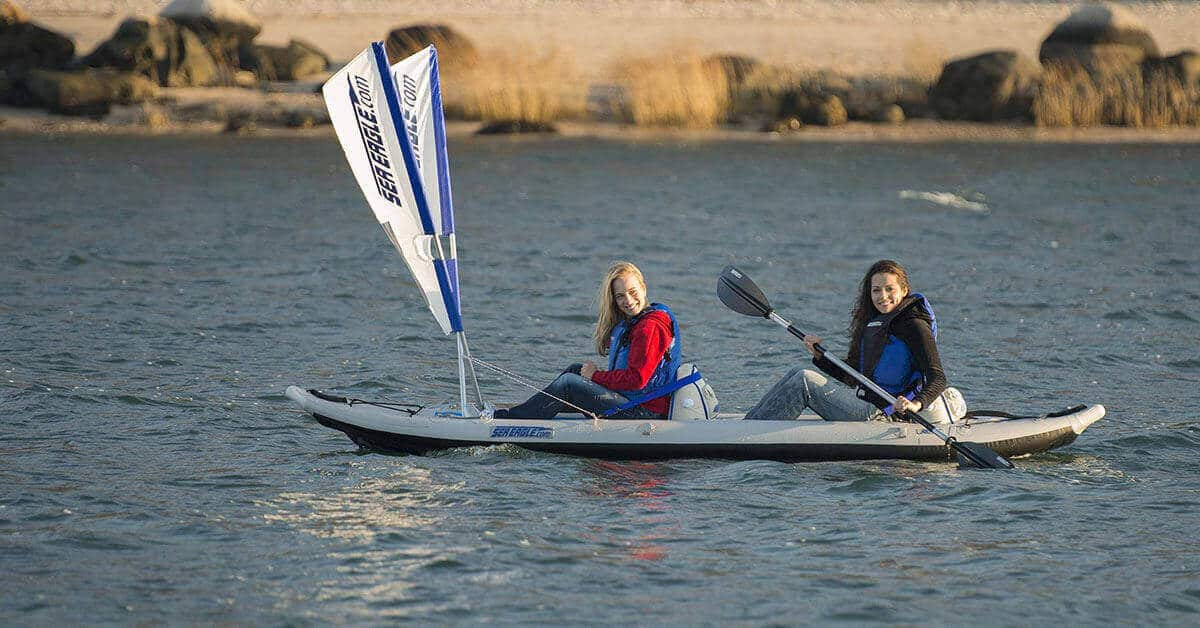 Tandem kayaking a Sea Eagle 385ft FastTrack two-person inflatable kayak with a QuikSail, universal kayak sail kit.