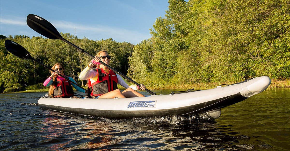 A Sea Eagle 465ft FastTrack inflatable 3-person kayak being used by two kayakers as a 2-person kayak.