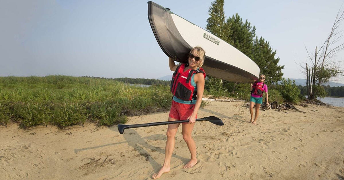 A 2-person carry of a Sea Eagle Inflatable Travel Canoe 16.