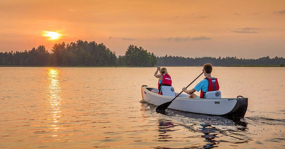 A romantic 2-person paddle in a Sea Eagle Inflatable Travel Canoe 16 at sunset.
