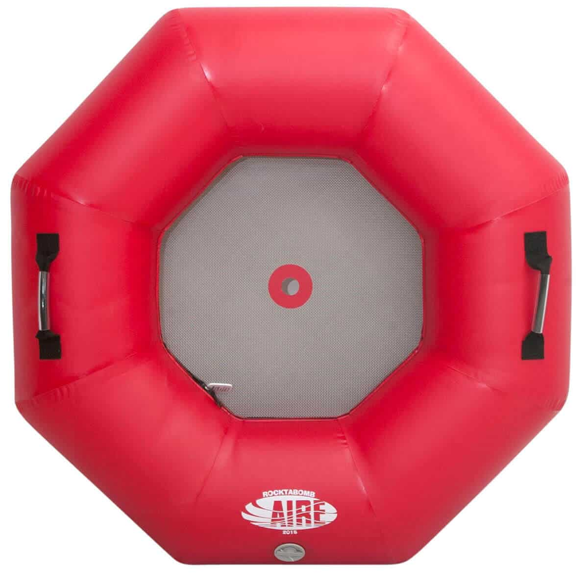 The top view of an AIRE Rocktabomb inflatable river tube in red.