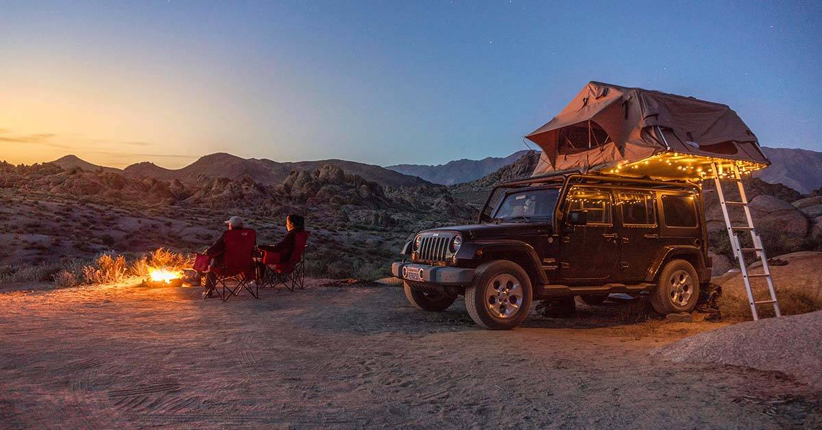 A roof-top tent on a Jeep Wrangler in the desert.