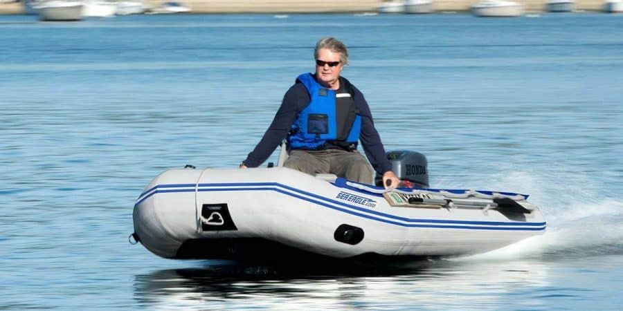 A Sea Eagle 10'6″ Sport Runabout Inflatable Boat racing at top speed.