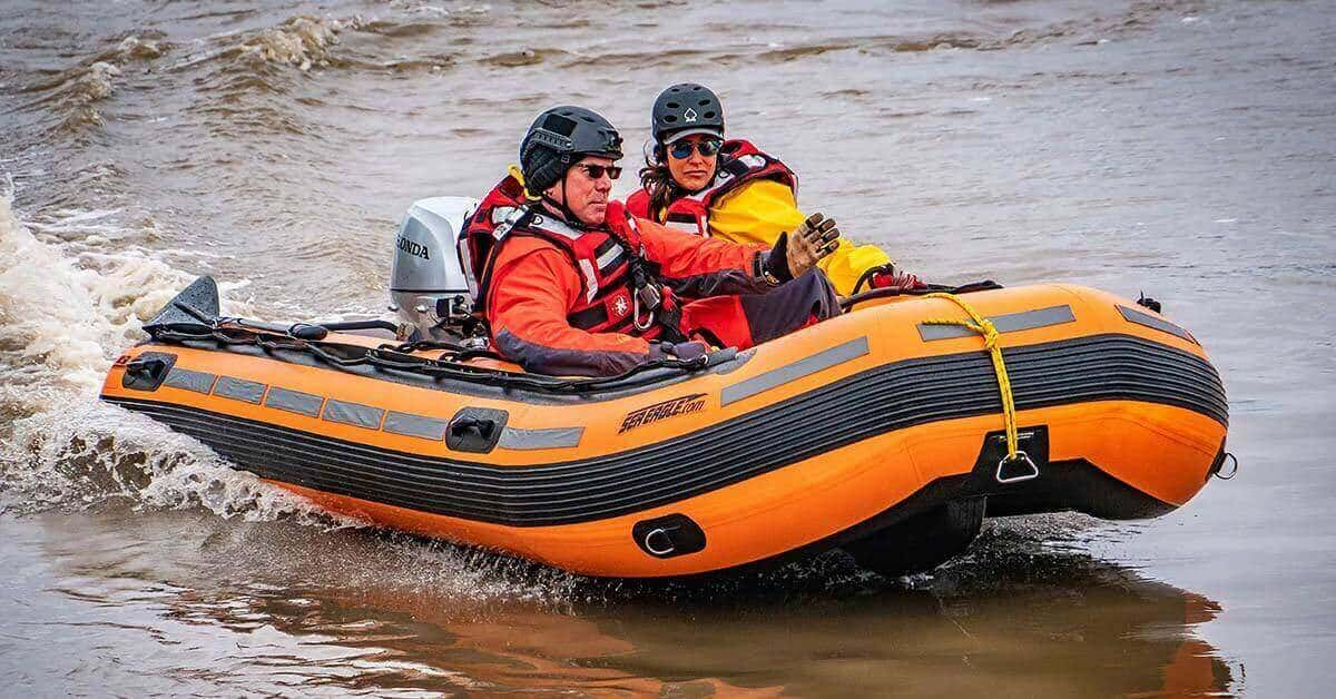 A Sea Eagle Rescue14 Sport Runabout Inflatable Boat being used in an open water rescue.
