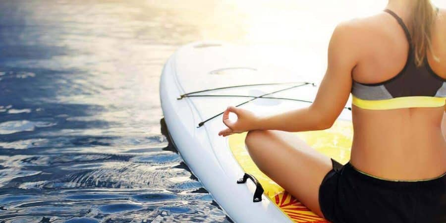 Stand-up paddle board (SUP) yoga basic poses.