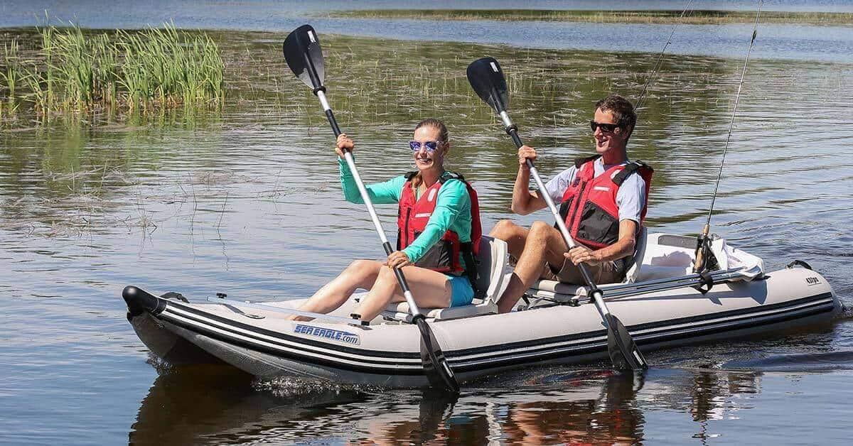 Two people paddling a Sea Eagle 437ps PaddleSki Inflatable Tandem Catamaran-Kayak-Boat.