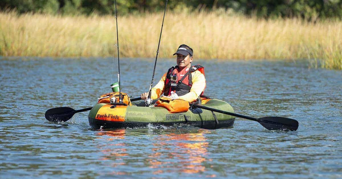 Rowing a Sea Eagle PackFish7 Inflatable Frameless Fishing Boat out on a lake.